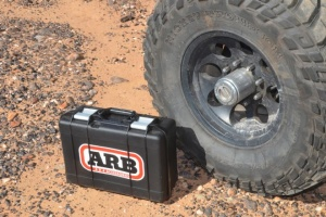 001-arb-air-compressor-test-lead-photo-product-next-to-tire-in-dirt